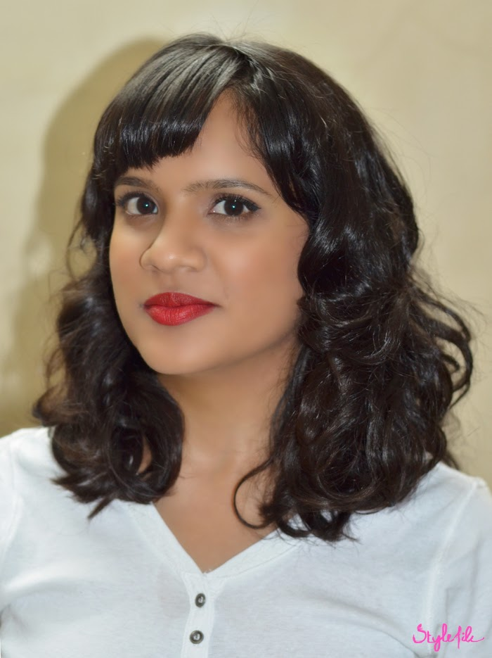 Dayle Pereira of Style File India wears a white shirt with red lips and a winged eyeliner sports a celebrity trending wavy long bob or lob hairstyle with curls