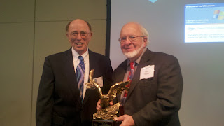 Eco-Tec's Jerry Brownstein presents Herb Pearse an award recognizing his work on the Gulf of Mexico oil spill clean-up