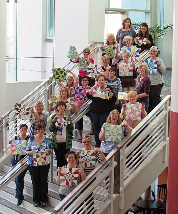 Happy quitlers with their Chopped quilt blocks