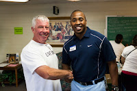 Image of Dr. Terry shaking hands with another volunteer