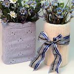 Dress up a glass or vase with a sweater sleeve cozy!