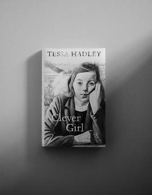 hardback novel with b/w figurative illustrated dust jacket