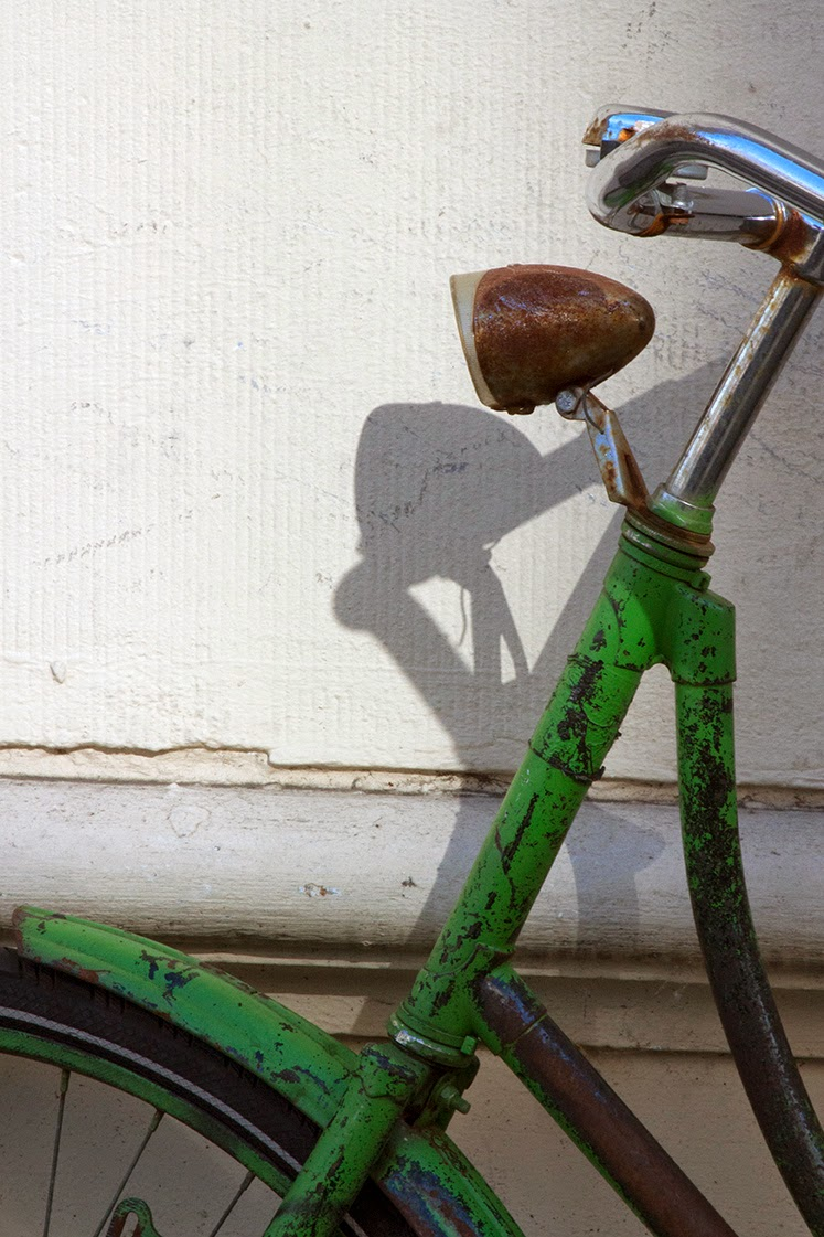 shadow of green bicycle