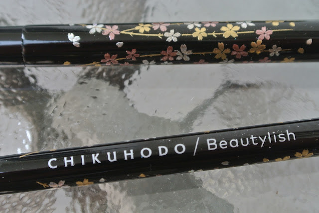 Close Up of Brush Logo and Cherry Blossom Detail