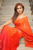 Sony Charista Glamorous in Saffron saree-thumbnail-12