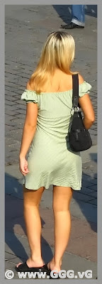 Girl in summer open back dress on the street