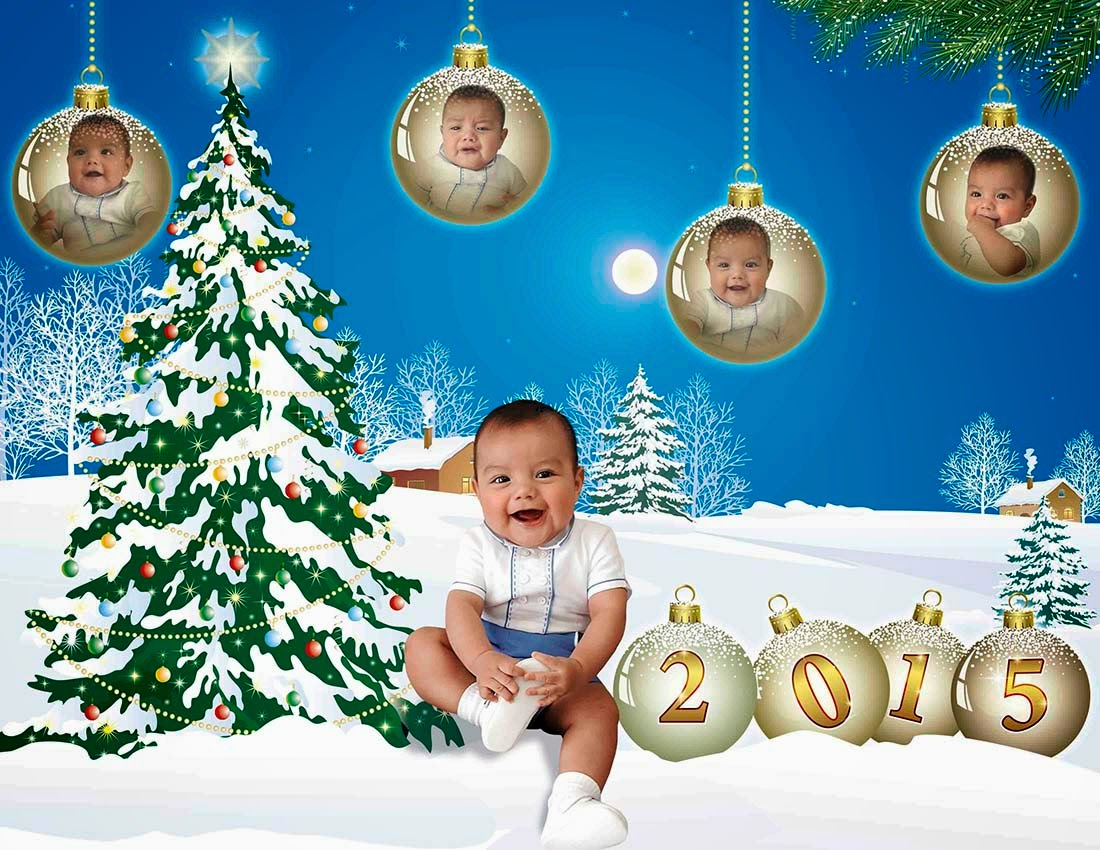 Bebé con árbol y esferas navideñas con el año 2015