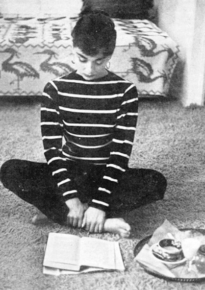 Audrey Hepburn reading a book