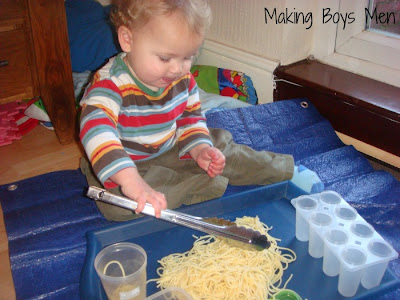 Baby play with spaghetti