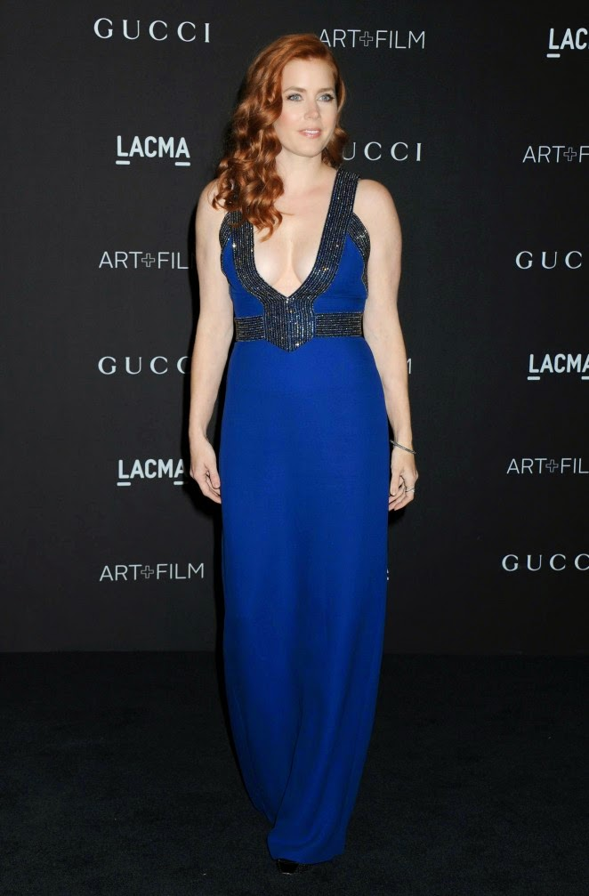 Amy Adams bares cleavage in a midnight blue gown at the 2014 LACMA Art + Film Gala