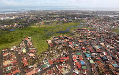 This handout photograph taken on November 10, 2013 and released by the Malacanang Photo Bureau (MPB) shows an aerial view of the damage in Leyte following Super Typhoon Haiyan in the area. The death toll from a super typhoon that decimated entire towns in the Philippines could soar well over 10,000, authorities warned Sunday, making it the country's worst recorded natural disaster.