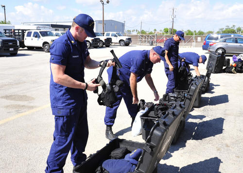 Maritime Safety and Security Team Galveston members prepare their law enforcement equipment for deployment to provide security for the Asian-Pacific Economic Cooperation Leadership Conference. U.S. Coast Guard photos by Petty Officer 2nd Class Michael Anderson.