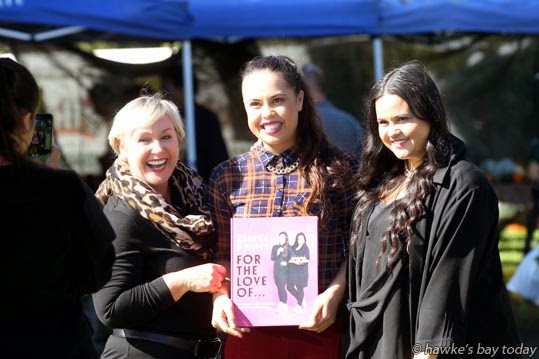 "L-R: Ann Gregor, Hawke's Bay Tourism with Kasey Bird and Karena Bird, sisters from Maketu, MasterChef winners, promoting their book, ""For The Love Of ..."" at Hastings Farmers Market, Hawke's Bay Showgrounds, Hastings. photograph"