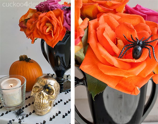 elegant and colorful Halloween decor with pink and orange roses