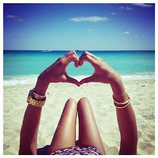 picture of loving: Heart made with two hands on the beach