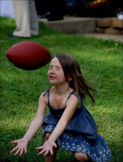 funny picture: a little girl misses rugby ball
