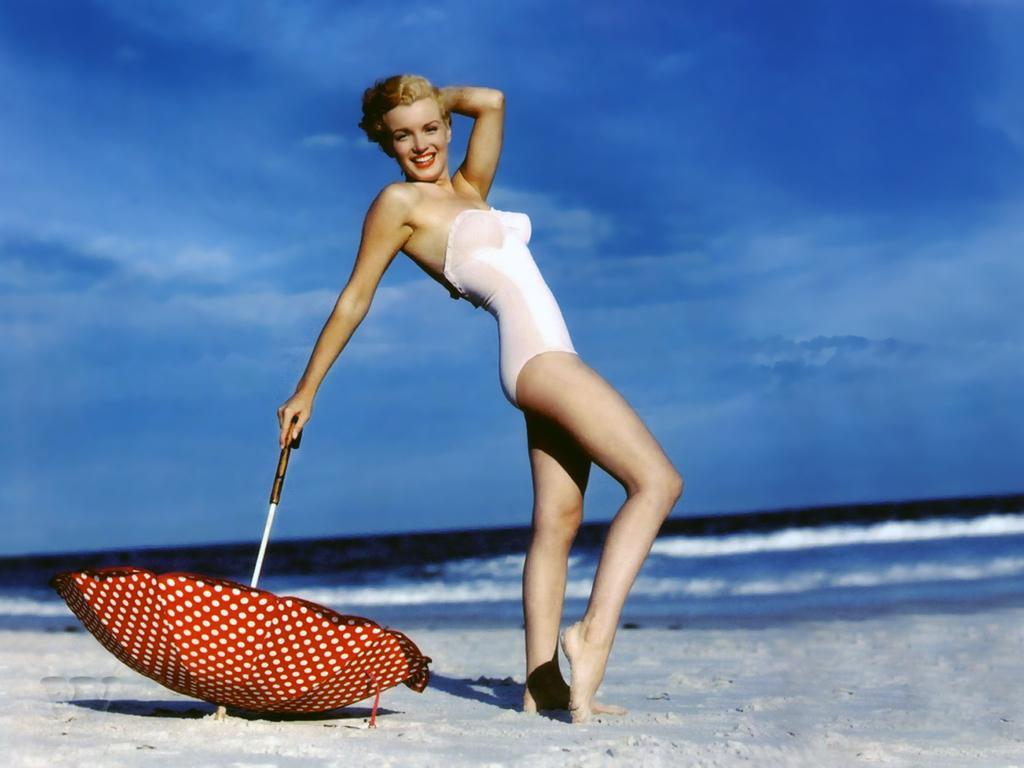 http://3.bp.blogspot.com/-t0wxDfrSCwE/TduJBHijxMI/AAAAAAAAAo0/dBNoJzflgmU/s1600/482648-1024x768-Marilyn-Monroe-beach-umbrella--color.jpg