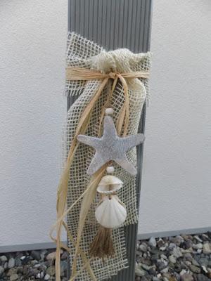 Gartendeko aus Holzpfosten maritim