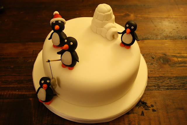 Christmas cake decorated with model Penguins