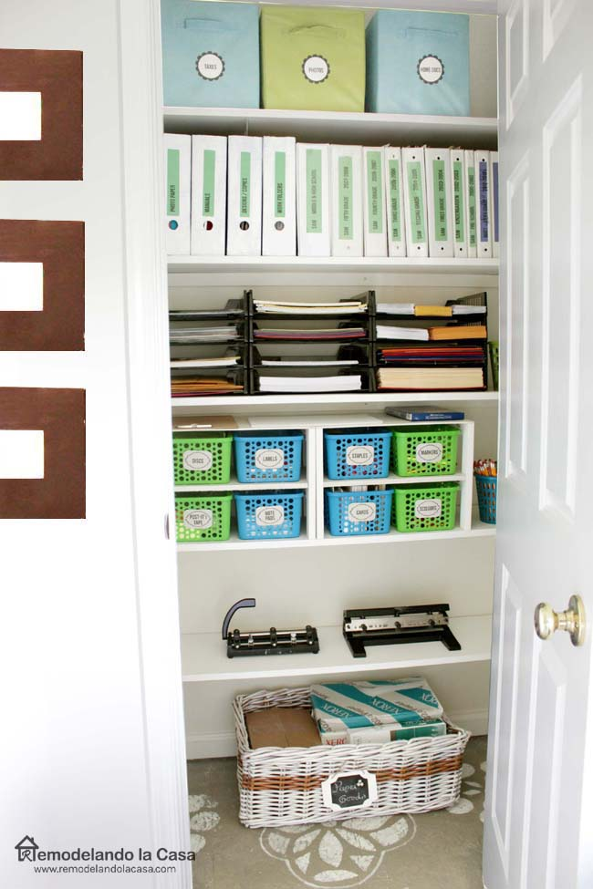 paper trays, fabric bins, plastic containers on shelves in office closet