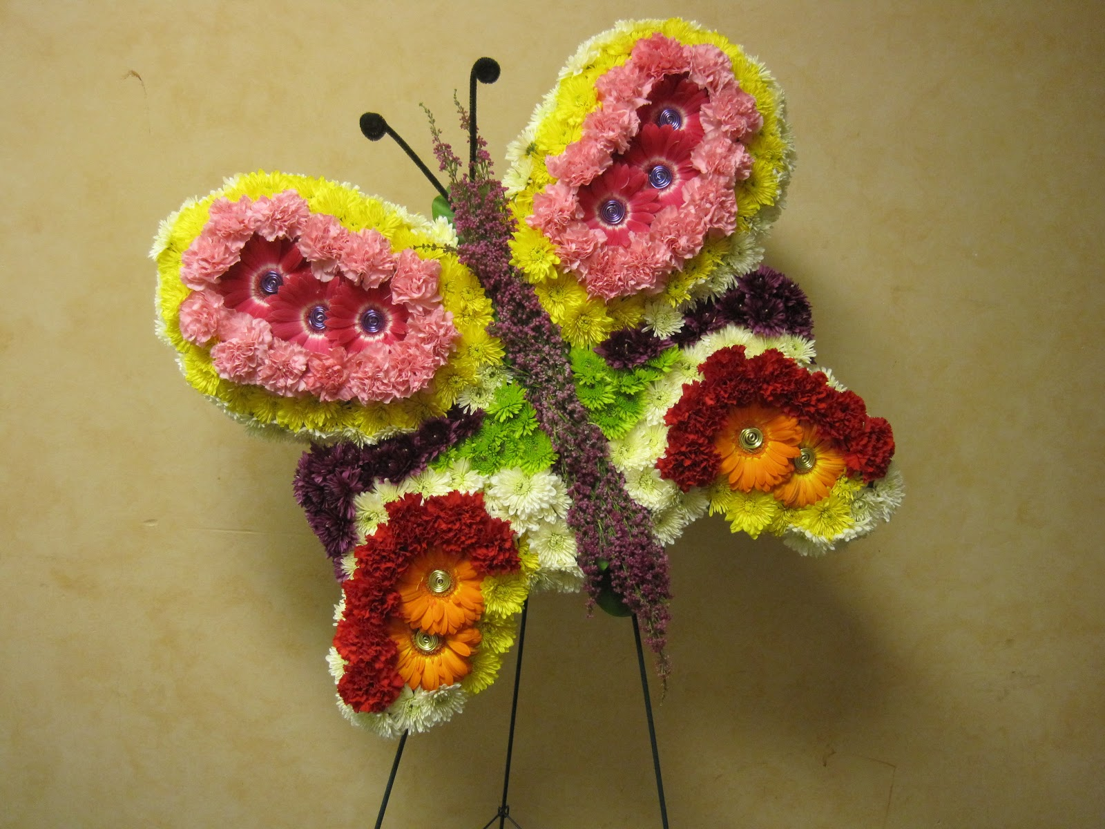 Plants flowers and such special funeral tributes helping create funeral tributes is a privilege for the designers at waukesha floral this past weekend denise and marty created a butterfly and a teddy bear izmirmasajfo