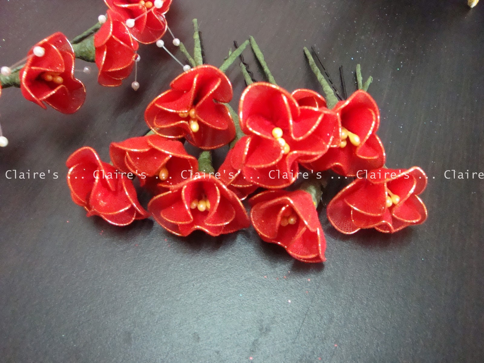 Claires party supplies red gold wedding flowers red stocking flowers on individual hair pins for bridesmaids izmirmasajfo Image collections