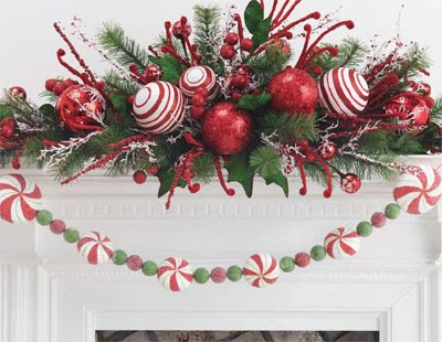 a super cute mantel decoration in red and white color combination the striped ornament and peppermint candy garland are perfect for the season