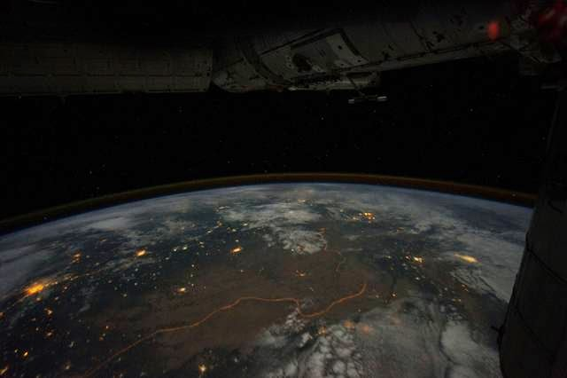 The bright orange line is the floodlit border zone between the two countries. The entire 1248 mile border is visible from space.