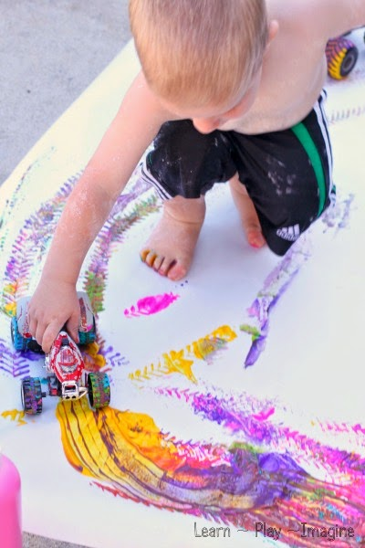 Painting with trucks - exploratory art for toddlers