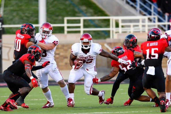 Samaje Perine #32 of the Oklahoma Sooners carries the ball against the Texas Tech Red Raiderson November 15, 2014 at Jones AT&T Stadium in Lubbock, Texas. Oklahoma won the game 42-30.
