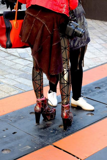 LFW orange tote and metallic pants