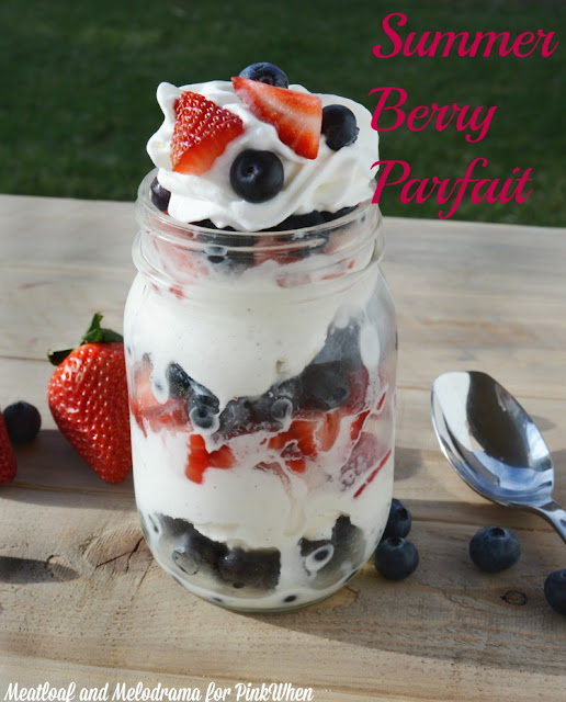Blueberries strawberries and ice cream layered in a mason jar