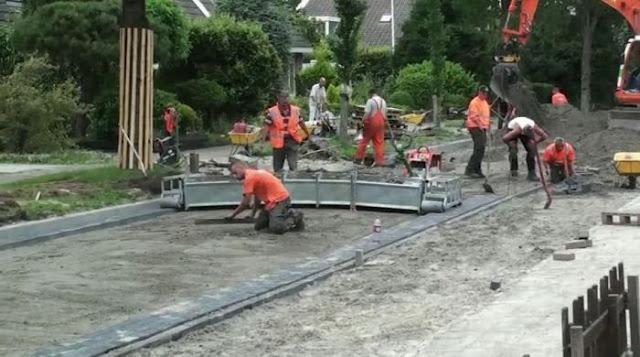Maquinário constrói 400 m2 de rua por dia