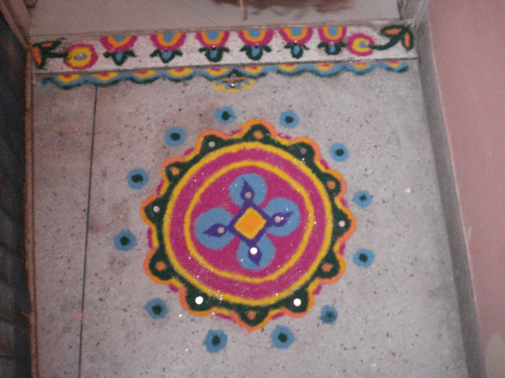 Rangoli designs diwali festival 2010 for Home made rangoli designs