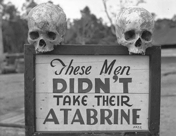 40 Must-See Photos Of The Past - Advertisement for Atabrine, anti-malaria drug, in Papua, New Guinea during WWII
