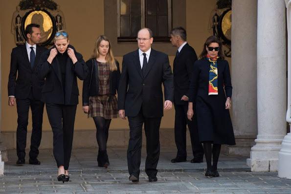 Prince Albert II of Monaco and Princess Charlene of Monaco, Princess Caroline of Hanover and Princess Alexandra observe a minute of silence on November 16, 2015 at the Monaco Palace