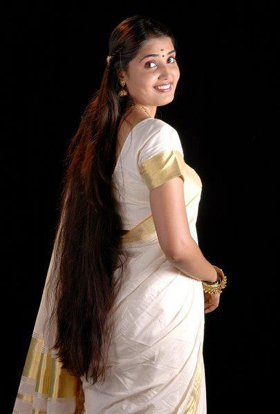 Long hair photography: Cute smiling and homely looking Indian long hair girl