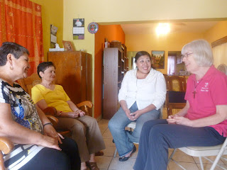 Sister Patricia Anne Clossey, far right, chats with Marta and Rosario, two members of a support group for widows in La Luz Parish in Guadalupe, Nuevo León, Mexico.  Psychologist Amanda Villanueva, second from right, facilitates the group.