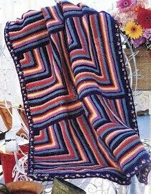 http://crochetenaccion.blogspot.com.es/2012/05/manta-festiva.html