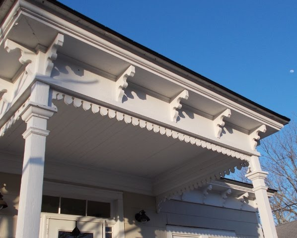 Cornice and hipped entrance portico have fine sawn brackets, turned drops at the portico.