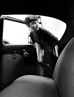 Audrey Hepburn gets into car at Paramount Studios, by Bob Willoughby