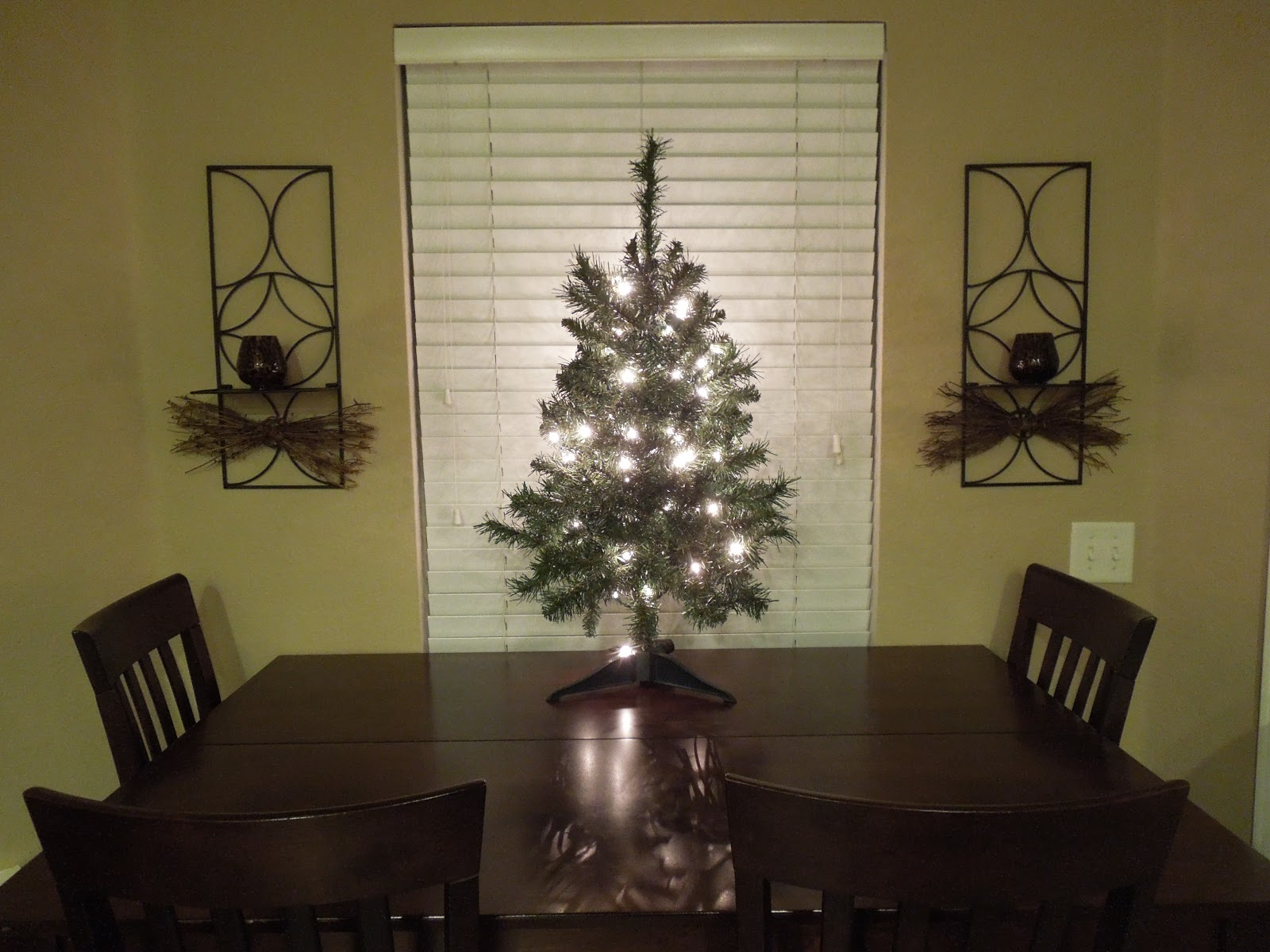 our christmas tree is now 3 feet tall and on top of our breakfast table no worries about ornaments breaking or a tree falling over