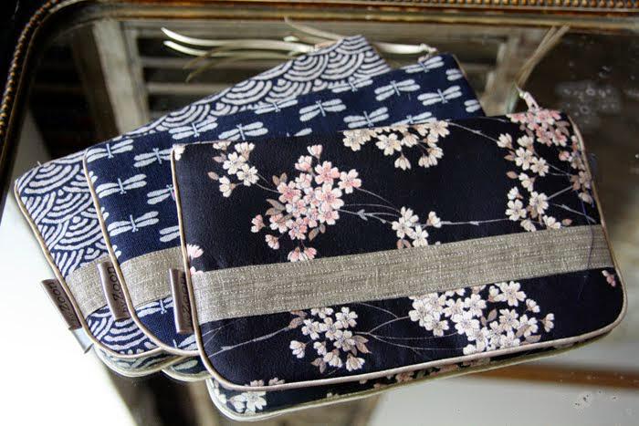 pochettes vague, libellule et geisha noir bande surpiquée bronze