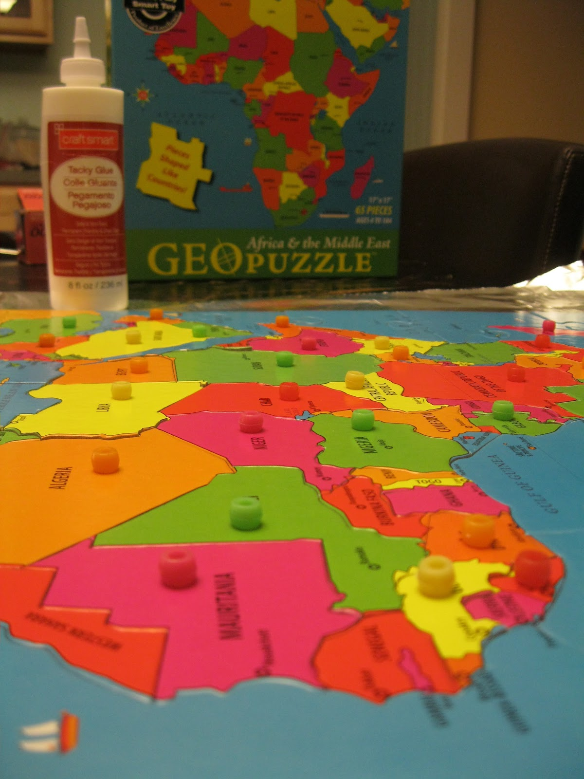 Montessori messy geography on the cheap part 2 making your own knobbed continent map puzzles on foam core gumiabroncs Images