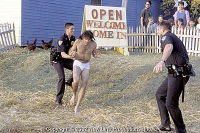David Cross as Ronnie running in his underwear chased by the police in Run Ronnie Run movieloversreviews.blogspot.com