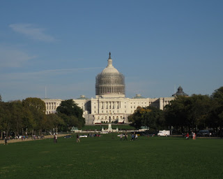 U. S. Capitol building with its dome under restoration, Washington, D.C.