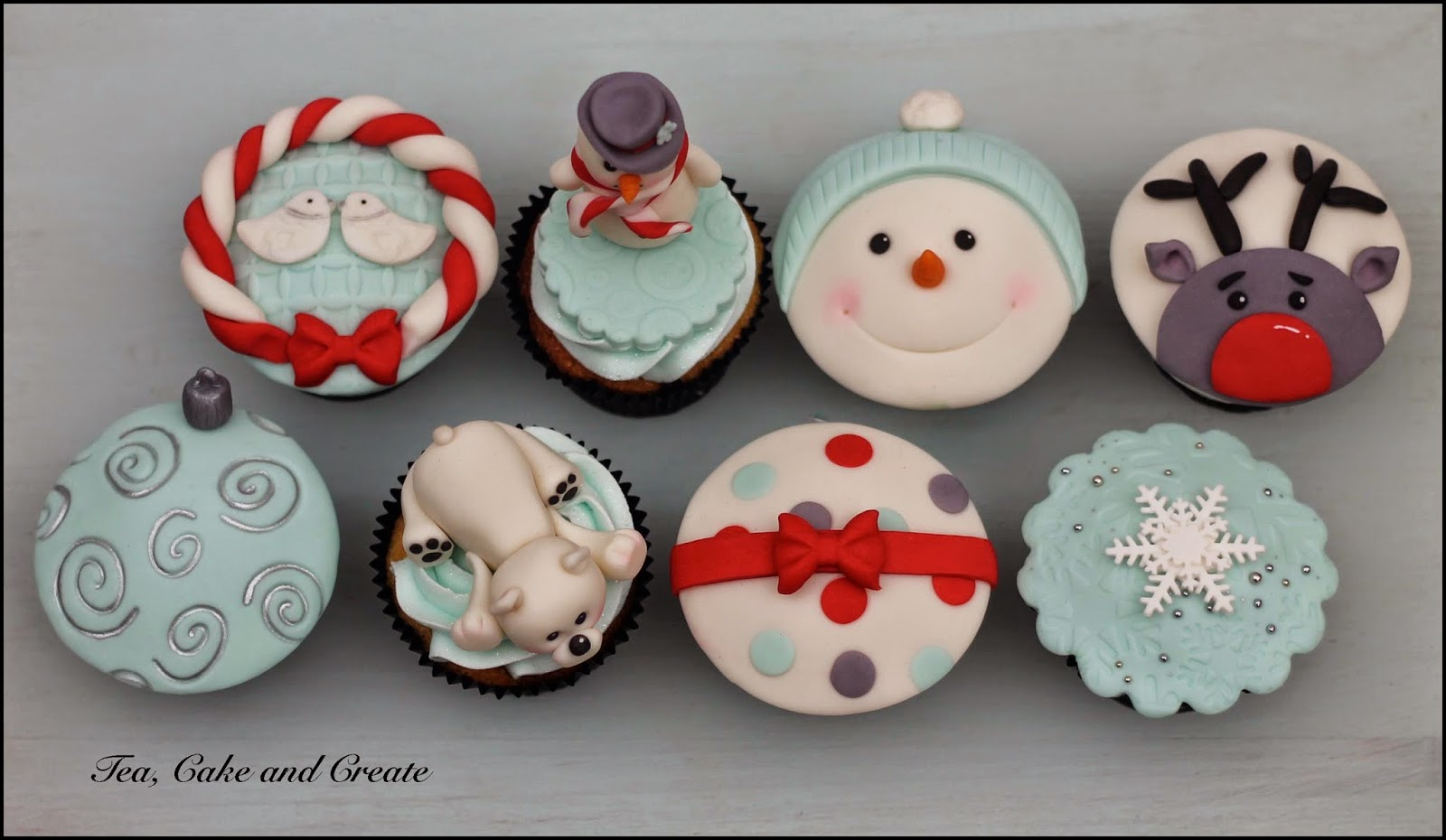 christmas cupcakes covered with fondant decorations made with modelling chocolate fondant mix excl the snowflakes those are cut out of tylose paste