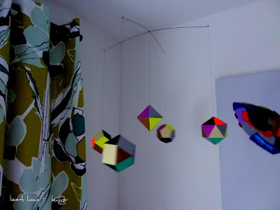 modern mobile paper shapes neon purple brown polyedra delicate geometric fice faceted ornaments  apartment therapy inspired