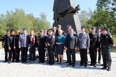 A delegation from LEMIT poses with high-ranking Polish officials during the Homo Homini ceremony memorializing 9/11 in Poland.