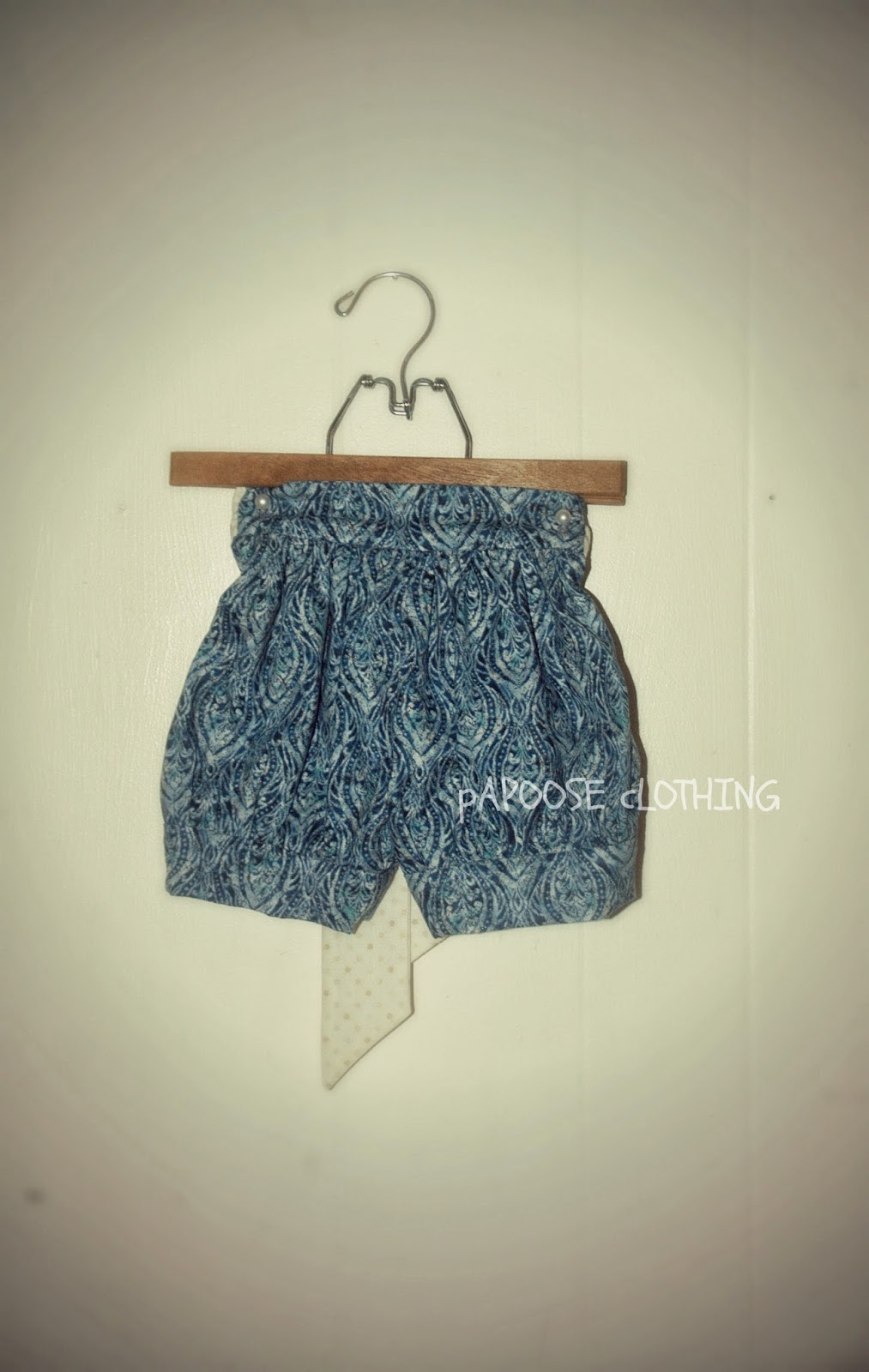 http://www.papooseclothing.com/store/p37/Pelican_Blue_Bubble_Cuff_Shorts_with_Side_Ties.html